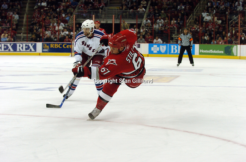 Carolina Hurricanes' Cory Stillman shoots for his last minute goal against the New York Rangers Tuesday, March 14, 2006 at the RBC Center in Raleigh, NC. Carolina won 5-3.