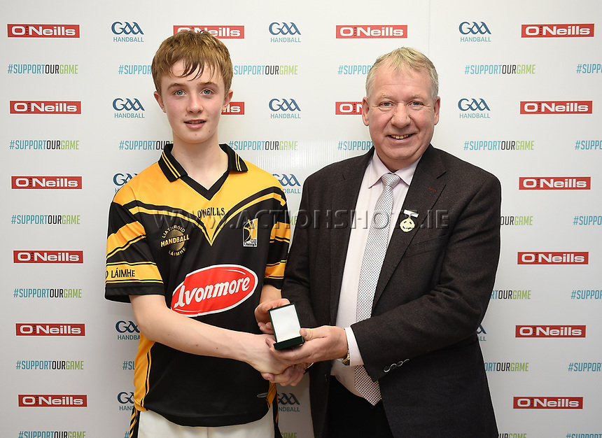 19/03/2018; 40x20 All Ireland Juvenile Championships Finals 2018; Kingscourt, Co Cavan;<br /> Boys Under-15 Singles; Kilkenny (John Doheny) v Tipperary (Rory Grace)<br /> John Doheny accepts his runners up medal from GAA Handball President Joe Masterson<br /> Photo Credit: actionshots.ie/Tommy Grealy
