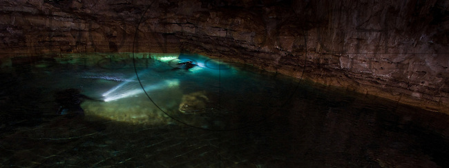 Clad in scuba gear and edging through narrow tunnels, researchers have found the stone ruins of sacred temples in cenotes around the state of Yucatan.