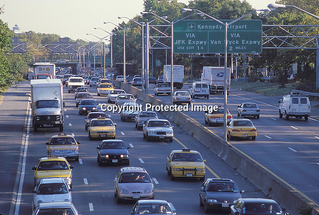 COAMENY35047.Country. United States of America. New York. JFK expressway from JFK airport to Manhattan. The characteristic cabs of this state. Board with name of highway. .©Per-Anders Petterson / iAFrika Photos
