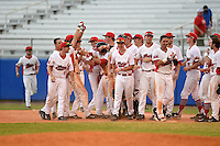 Illinois State Redbirds Sean Beesley (hands up) is mobbed by teammates after a walk off hit during a game against the Bowling Green Falcons on March 11, 2015 at Chain of Lakes Stadium in Winter Haven, Florida.  Illinois State defeated Bowling Green 8-7.  (Mike Janes/Four Seam Images)