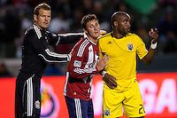 Columbus Crew forward Emilio Renteria (20) gets shoved by defender Ben Zemansk (21) and goal keeper Dan Kennedy of Chivas USA. Chivas USA and Columbus Crew played to a 0-0 tie at Home Depot Center stadium in Carson, California on  April  9, 2011....