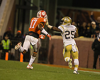 The eighth ranked Clemson Tigers defeat the Georgia Tech Yellow Jackets at Death Valley 55-31 in an ACC matchup.  Georgia Tech Yellow Jackets running back Robert Godhigh (25)  straight arms Clemson Tigers defensive back Bashaud Breeland (17) on his way to a touchdown