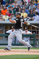 Melky Cabrera (53) of the Chicago White Sox follows through on his swing against the Charlotte Knights at BB&T Ballpark on April 3, 2015 in Charlotte, North Carolina.  The Knights defeated the White Sox 10-2.  (Brian Westerholt/Four Seam Images)