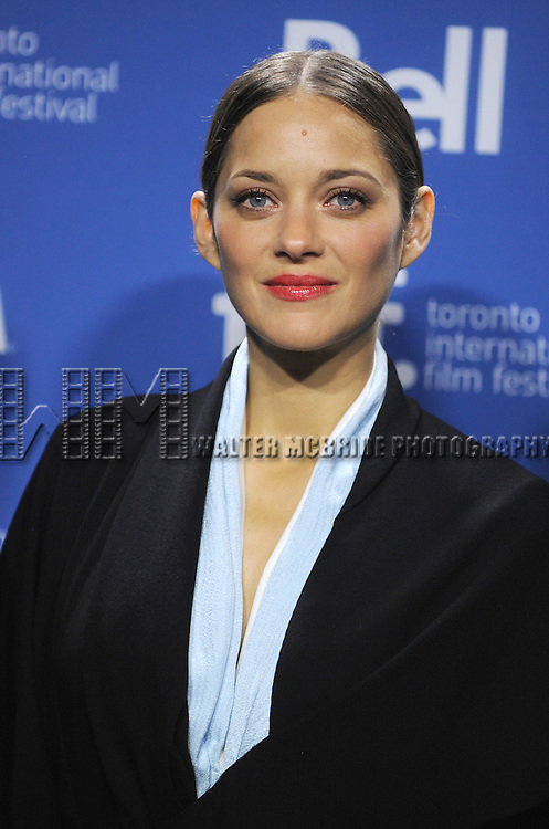"Marion Cotillard attending the 2013 Tiff Film Festival Photo Call for ""Blood Ties""  at the Tiff Bell Lightbox on September 10, 2013 in Toronto, Canada."