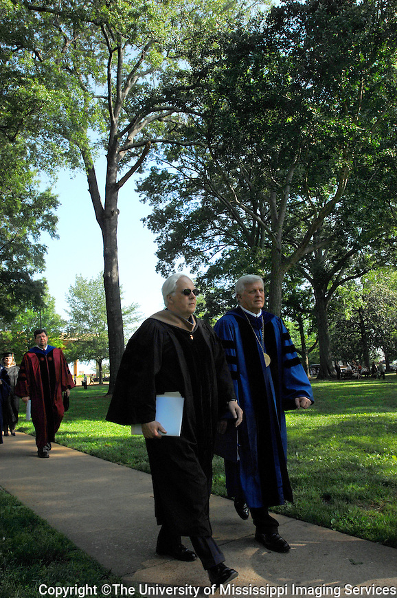 Fred Smith, founder, chair and CEO of FedEx, left, and Robert Khayat, Chancellor of The University of Mississippi, right, lead a processional through the Grove on their way to Ole Miss' commencement ceremonies where Smith was the keynote speaker, today, Saturday, May 12, 2007.(AP PHOTO/The University of Mississippi/Kevin Bain)
