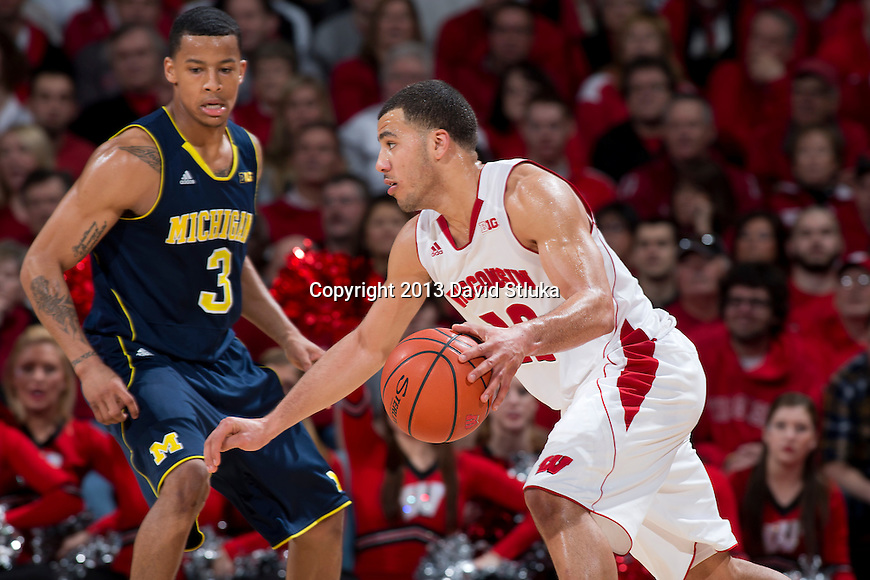 Wisconsin Badgers guard Traevon Jackson (12) handles the ball during a Big Ten Conference NCAA college basketball game against the Michigan Wolverines Saturday, February 9, 2013, in Madison, Wis. The Badgers won 65-62 (OT). (Photo by David Stluka)