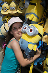 A girl hugs a Despicable Me Minion doll at Universal Studios Hollywood, Los Angeles, CA