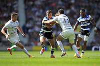 George Ford of Bath Rugby is tackled by Brad Barritt of Saracens during the Aviva Premiership Rugby Final between Bath Rugby and Saracens at Twickenham Stadium on Saturday 30th May 2015 (Photo by Rob Munro)