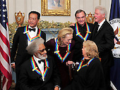 Former United States President Bill Clinton joins the five recipients of the 2011 Kennedy Center Honors after they posed for a photo following a dinner hosted by United States Secretary of State Hillary Rodham Clinton at the U.S. Department of State in Washington, D.C. on Saturday, December 3, 2011. Back row, from left to right: musician Yo-Yo Ma; actress Meryl Streep; singer Neil Diamond; President Clinton. Front row, from left to right: musician Sonny Rollins; and actress Barbara Cook..Credit: Ron Sachs / CNP