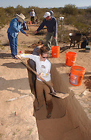 Ashley Blythe .a university of arizona .student shovels dirt to be screened of dirt from.the Marana Platform mound looking for.shards and other artifacts from the .mound occupied for 100 years by the HoHoKam.people from 1200 ad to 1300 ad...