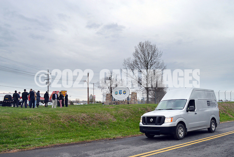 A van passes by as media gathers around Congressman Brendan F. Boyle (D-PA) and Congressman Patrick Meehan (R-PA) during a joint press conference to call upon the EPA to do more to protect area residents from contaminated drinking water Monday, April 11, 2016 at Horsham Air Guard Station in Horsham, Pennsylvania.  (Photo by William Thomas Cain)