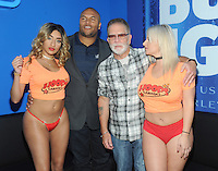 NEW YORK, NY - October 7: Former New York Giant Antonio Pierce attends the grand opening of Hoops Cabaret and Sports Bar on 33rd street  in New York City. Pierce posed with the Hoops Cabaret girls and also cut the ribbon officially opening the newest edition to New York late night scene.  Pierce was also joined at Hoops by Ronnie the Limo Driver from Howard Stern Fame. Photo by John Palmer/MediaPunch