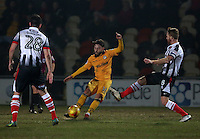 Josh Sheehan of Newport County is challenged by Craig Disley of Grimsby Town during the Sky Bet League Two match between Newport County and Grimsby Town at Rodney Parade, Newport, Wales, UK. Tuesday 14 February 2017