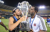 DC United midfielder Fred (7) kisses the Lamar Hunt US. Open Cup with teammate forward Luciano Emilio (11) after the win, DC United defeated The Charleston Battery 2-1, to win the  Lamar Hunt U.S. Open Cup at RFK Stadium in Washington DC, Saturday September 3, 2008.