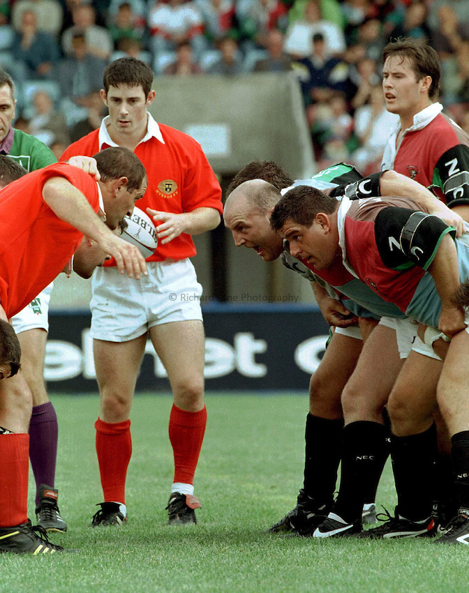 Photo : Ken Brown.7.9.97 Heineken Cup, Harlequins v Munster.Massimo Cuttitta & Keith Wood face up to the Munster front row