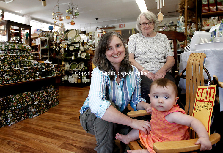 Southbury, CT- 27 August 2014-082714CM01-   Marie Anctil, owner of Marie's Country Furnishings, sits with her daughter, Therese Anctil and granddaughter (and Therese's daughter, Charlotte, 7 months) inside the store in Southbury on Wednesday. The family will be closing the business after being open for about 40 years.    Christopher Massa Republican-American