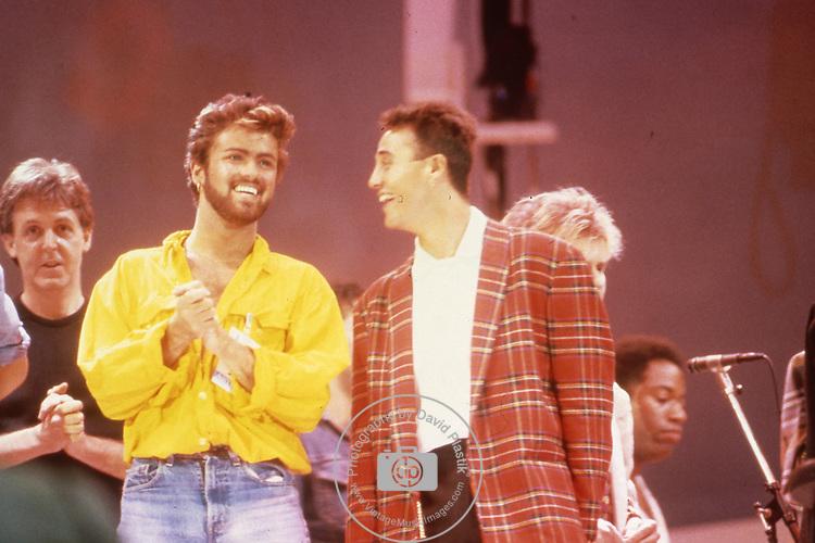Paul McCartney, George Michael & Andrew Ridgeley of Wham at Live Aid at Wembley Stadium England. Live Aid 1985 Wembley Stadium, London , England