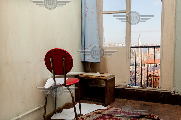 A film script scattered on the floor of a small room overlooking a minarette and the Bosphorus.