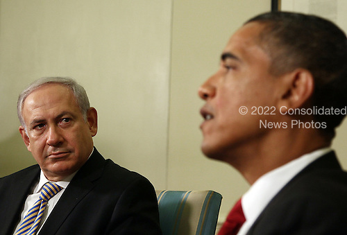 Prime Minister Benjamin Netanyahu of Israel (L) listens to United States President Barack Obama (R) speak in the Oval Office at the White House on Tuesday, July 6, 2010 in Washington, DC. The two leaders spoke to reporters and are scheduled to participate in a working lunch.  .Credit: Mark Wilson - Pool via CNP
