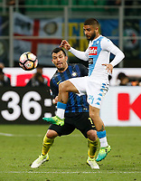 Lorenzo Insigne  of SSC Napoli Gary Medel  during the  italian serie a soccer match,between Inter FC  and SSC Napoli      at  the San Siro   stadium in Milan  Italy , April  30, 2017