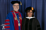 The Rev. Dennis H. Holtschneider, C.M., president of DePaul, left, and commencement speaker and honorary degree recipient Sharon Draper, a distinguished teacher and celebrated novelist. DePaul University College of Education held its commencement ceremony, Saturday, June 10, 2017, at the Rosemont Theatre in Rosemont, IL. The Rev. Dennis H. Holtschneider, C.M., president of DePaul, conferred the degrees. (DePaul University/Jeff Carrion)