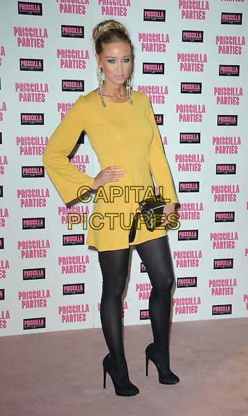 LAUREN POPE .Attending the launch of 'Priscilla Parties' at the Palace Theatre,  London, England, UK, January 24th 2011..full length yellow long sleeve dress black tights heels shoes clutch bag .CAP/WIZ.© Wizard/Capital Pictures.