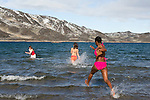 Students from the Cape Farewell Youth Expedition brave the freezing waters of the Arctic for a polar bear swim. The students are part of the Cape Farewell Youth Expedition that was organized by the British Council of Canada. Here they are swimming in Butterfly Bay, Nunavut, Canada.