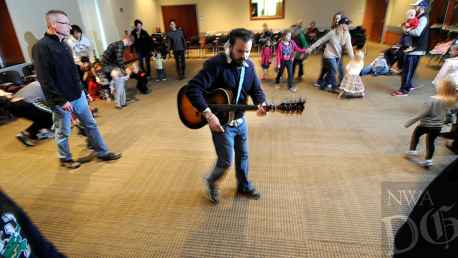 """NWA Media/ J.T. Wampler - Jeremy Babcock of Chicago performs """"She'll be Coming Round the Mountain When She Comes"""" Saturday Dec. 27, 2014 at the Fayetteville Public Library. Babcock also performs with the band Dreamtree Shakers."""