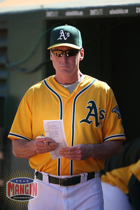 OAKLAND, CA - SEPTEMBER 22:  Manager Bob Melvin #6 of the Oakland Athletics watches from the dugout during the game against the Minnesota Twins at O.co Coliseum on Sunday, September 22, 2013 in Oakland, California. Photo by Brad Mangin