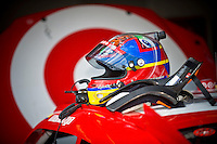 The helmet, HANS Device and radio of Juan Pablo Montoya (#42) sit on the roof of his car.