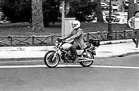 Roma  1985.Motociclista su una Moto Guzzi.Motorcycle on a Moto Guzzi