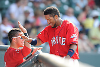 Second baseman Wendell Rijo (11) of the Greenville Drive is congratulated after scoring a run in a game against the Augusta GreenJackets on Sunday, July 13, 2014, at Fluor Field at the West End in Greenville, South Carolina. Rijo is the No. 18 prospect of the Boston Red Sox, according to Baseball America. Greenville won, 8-5. (Tom Priddy/Four Seam Images)