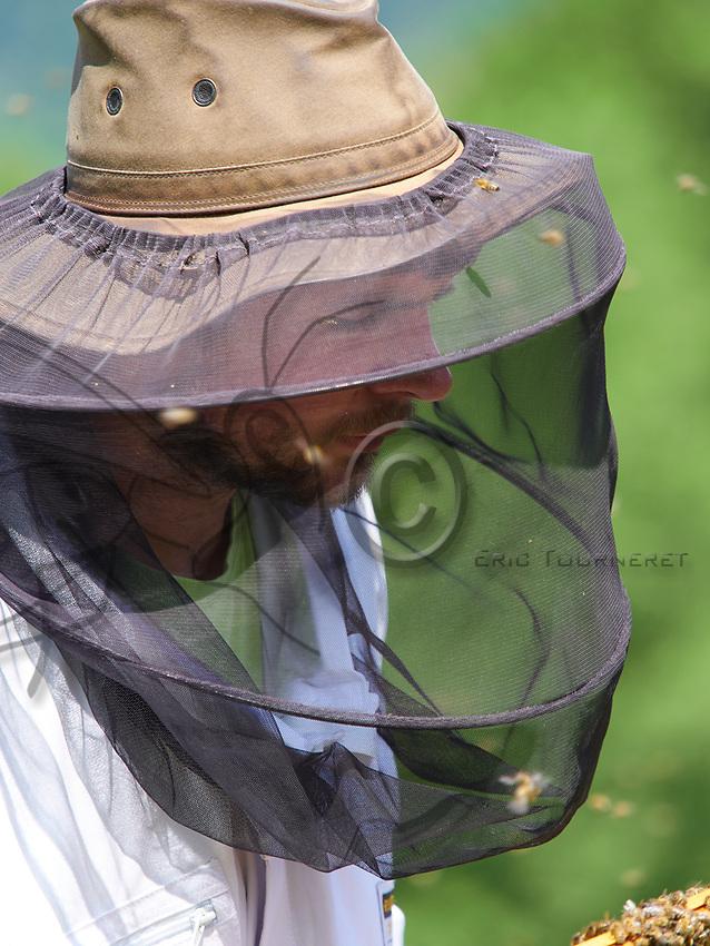 Beekeeping operation: Portrait of Damien Blampey in an apiary near Favergue, France.<br /> Portrait de Damien Blampey sur son rucher pr&egrave;s de Favergue- France.