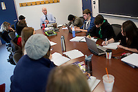 Assistant Professor of Geology David Szymanski of Bentley University's Department of Natural and Applied Science leads students in a discussion about pollution and water supplies in a seminar of the NASE402 Science in Environmental Policy course in Waltham, Massachusetts, USA.  The class involves an optional extra section that includes a trip to Washington, D.C., to meet with policy makers and discuss the role of science in making government policy.