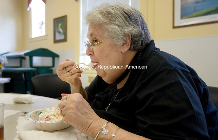 MIDDLEBURY CT. 24 July 2014-072414SV12-Sandy Goldberg of Middlebury enjoys ice cream at the senior center in Middlebury Thursday. The seniors had an Ice Cream Social after their afternoon lunch. <br /> Steven Valenti Republican-American