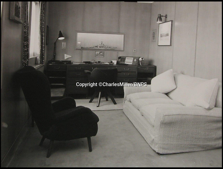 BNPS.co.uk (01202 558833)<br /> Pic: CharlesMiller/BNPS<br /> <br /> ***Must use full byline***<br /> <br /> Prince Phillip's study.<br /> <br /> Rare photographs showing the complete construction of the much-loved Royal yacht Britannia have surfaced 60 years later.<br /> <br /> The image archive was recorded by shipbuilders John Brown &amp; Co during the 10 months it took to build the 412ft long vessel for Queen Elizabeth II.<br /> <br /> The 70 black and white photos document virtually every stage of the project, from the laying of the keel in June 1952 to the furnishing of state dining room in April 1953.<br /> <br /> They show cloth-capped, blue collar engineers hard at work while management in smart suits and bowler hats carefully inspect the build.<br /> <br /> Some of the shots of the yacht in dry dock show it covered in scaffolding and highlight the two enormous propellers at the stern.