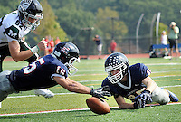CB East's Ryan Stout #15 and Brian Stella #45 dive onto a loose ball after a blocked punt for a touchdown against Methacton in the first quarter Saturday September 10, 2016 at Central Bucks East High School in Buckingham, Pennsylvania. CB East defeated Methacton 42-6. (Photo by William Thomas Cain)