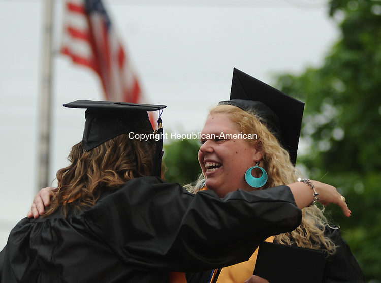 WINSTED, CT-24 MAY 2012--052412JS18-Northwestern Connecticut Community College graduate Catrina Schafini, right, gives a hug to her friend, and fellow graduate,  Alayna Sholtis ,  during graduation ceremonies Thursday in Winsted. . Jim Shannon Republican-American