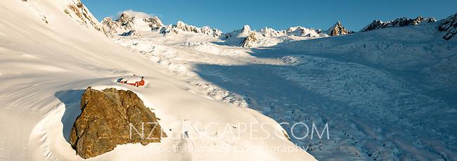 Mountaneering alpine shelter, Almer Hut in upper parts of  Franz Josef Glacier at winter sunset, Westland Tai Poutini National Park, West Coast, UNESCO World Heritage Area, New Zealand, NZ