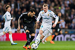 Dani Alves (L) of Paris Saint Germain fights for the ball with Toni Kroos of Real Madrid during the UEFA Champions League 2017-18 Round of 16 (1st leg) match between Real Madrid vs Paris Saint Germain at Estadio Santiago Bernabeu on February 14 2018 in Madrid, Spain. Photo by Diego Souto / Power Sport Images