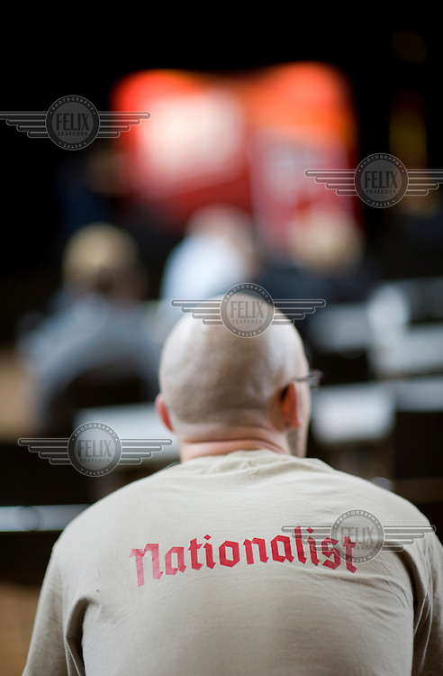 Member with the word 'Nationalist' on the back of his t-shirt at the start of the election campaign of the right-wing party NPD and DVU, the new Die Volksunion, in Berlin-Lichtenberg.