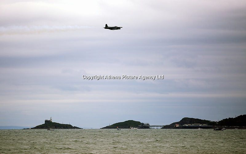 Pictured: One of the aeroplanes of the show flies over Mumbles. Saturday 01 July 2017<br /> Re: National Wales Air Show in Swansea Bay, Wales, UK.