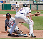 Sacramento River-Cats runner Jermaine Mitchell slides in safely as Reno Aces third baseman Ryan Wheeler takes the throw in their game played on Sunday afternoon, April 22, 2012 in Reno, Nevada.