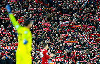 Liverpool fans hold scarves as they sing before kick off<br /> <br /> Photographer AlexDodd/CameraSport<br /> <br /> The Premier League - Liverpool v Manchester United - Sunday 16th December 2018 - Anfield - Liverpool<br /> <br /> World Copyright © 2018 CameraSport. All rights reserved. 43 Linden Ave. Countesthorpe. Leicester. England. LE8 5PG - Tel: +44 (0) 116 277 4147 - admin@camerasport.com - www.camerasport.com
