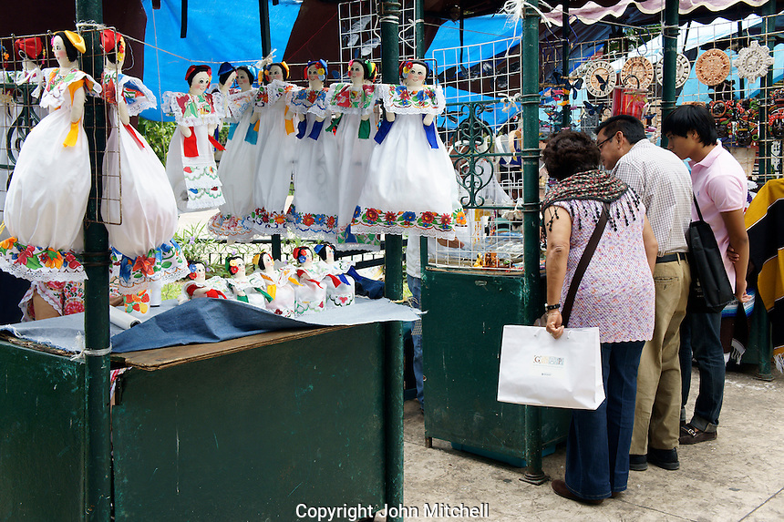 Shoppers and stalls at the Sunday handicrafts markets in the main square, Merida, Yucatan, Mexico...