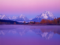 749450004 dawn alpenglow lights up mount moran and the teton range on a fall morning at oxbow bend of the snake river in grand tetons national park wyoming