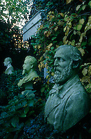 Busts of famous writers and thinkers are scattered throughout the garden