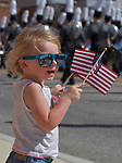 Moira Scannell, 2 of Swansea, waves American flags that parade participants handed out at the annual Belleville Labor Day Parade held on Monday September 3, 2018. It was Moira's first time attending the Belleville parade, her father Ryan Scannell said. <br /> Photo by Tim Vizer