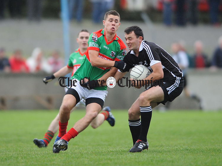 Mark Killeen of Kilmurry IBrickane in action against David Tubridy of Doonbeg during their semi-final meeting at Cooraclare. Photograph by John Kelly.